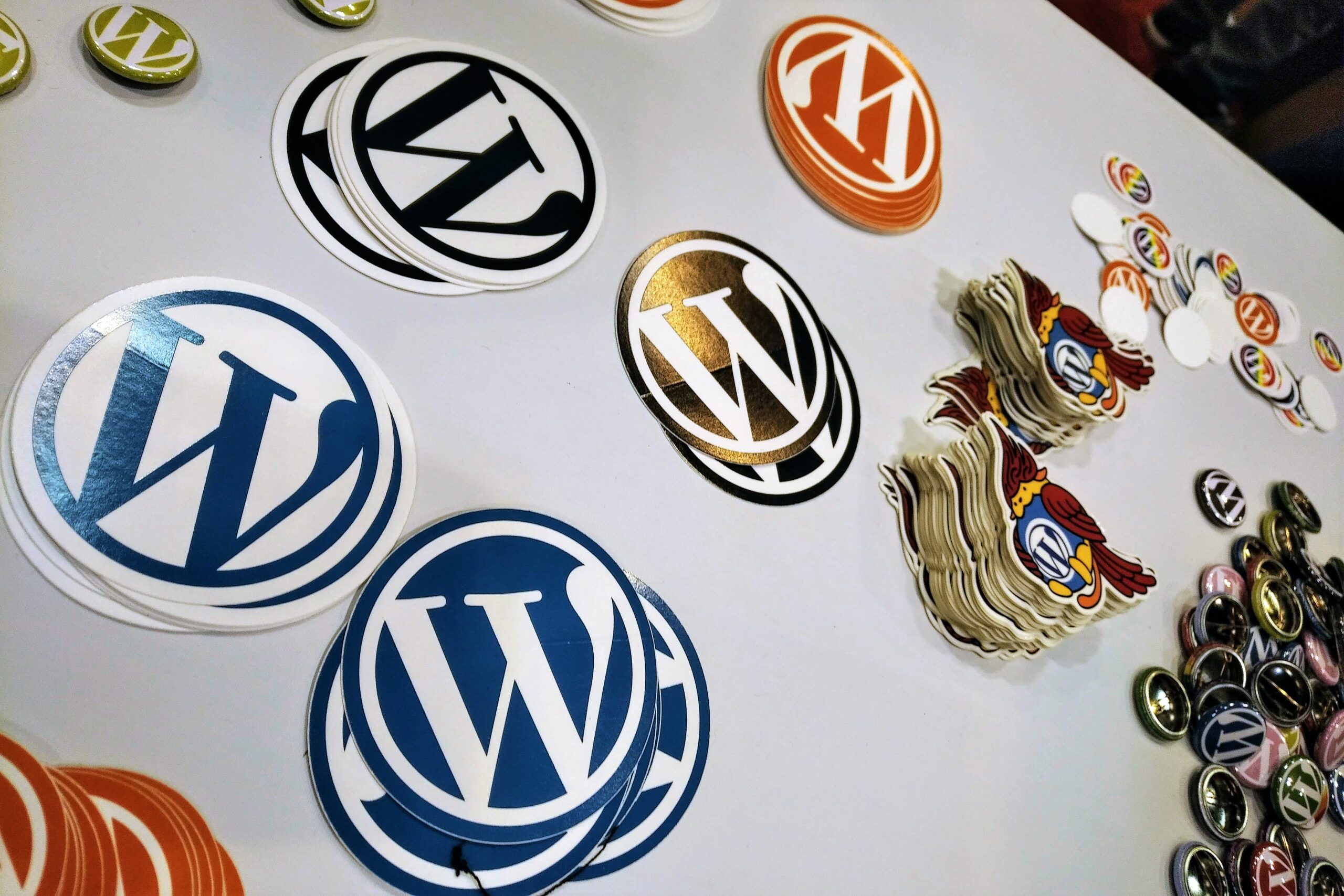 A table of WordPress stickers from WordCamp US 2019 in St. Louis